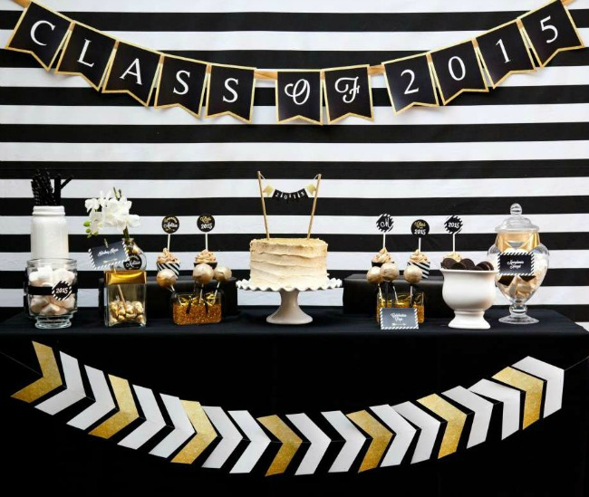 Classic black, gold, and white graduation party decorations