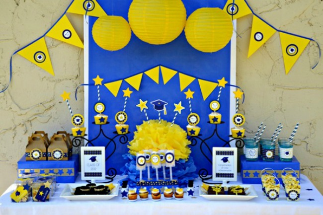 Yellow and blue graduation party dessert table