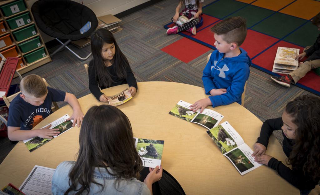 Kindergarten students work with teacher