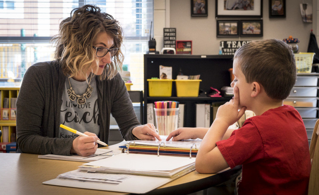Teacher working with Kindergarten student