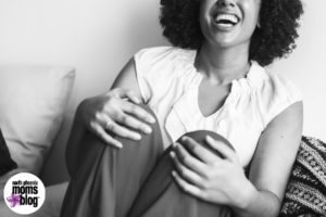 Woman laughing out loud with happiness